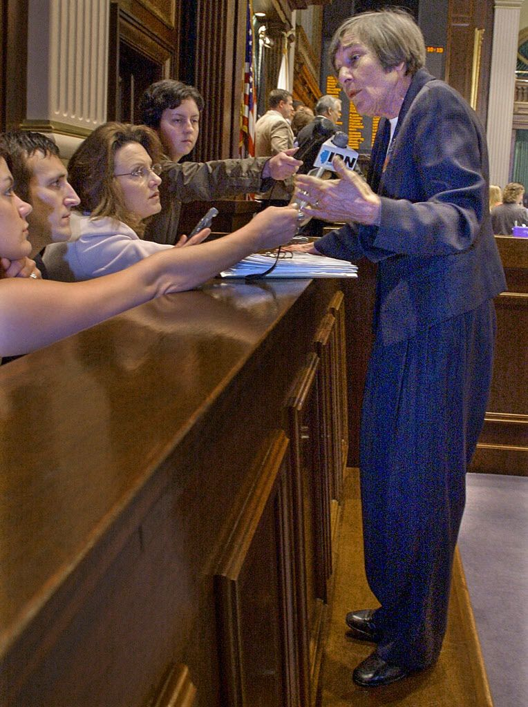 House Majority Leader Barbara Flynn Currie, D-Chicago, stands up on the House pages' bench to speak to reporters in 2004.   Seth Perlman/AP file photo