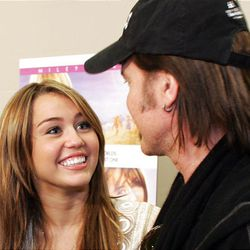"""Miley Cyrus and her father, Billy Ray Cyrus, talk with members of the media Friday at the Megaplex 20 in South Jordan, prior to the premiere of her movie, """"Hannah Montana."""""""