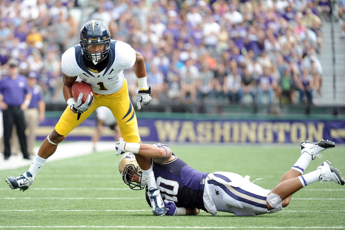 SEATTLE, WA - SEPTEMBER 24:  Marvin Jones #1 of the California Golden Bears is tackled by John Timu #10 after a catch during the second quarter at Husky Stadium on September 24, 2011 in Seattle, Washington.  (Photo by Harry How/Getty Images)