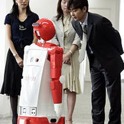 """The robot """"enon"""" greets Fujitsu employees during a demonstration in Tokyo. The robot is equipped with voice recognition capabilities, cameras and sensors. Enon can find its way around an office or store."""