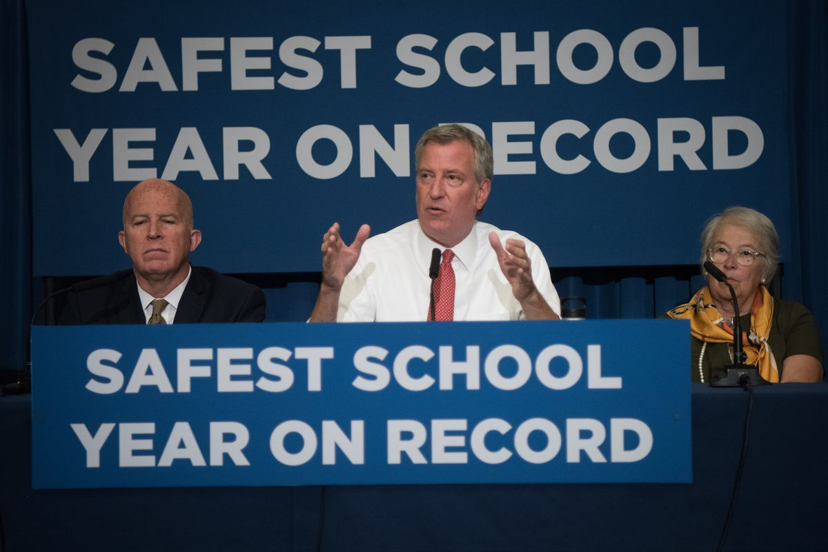 Mayor Bill de Blasio, flanked by police Commissioner James O'Neill and Chancellor Carmen Fariña held a press conference on school safety at M.S. 88 in Brooklyn in August.