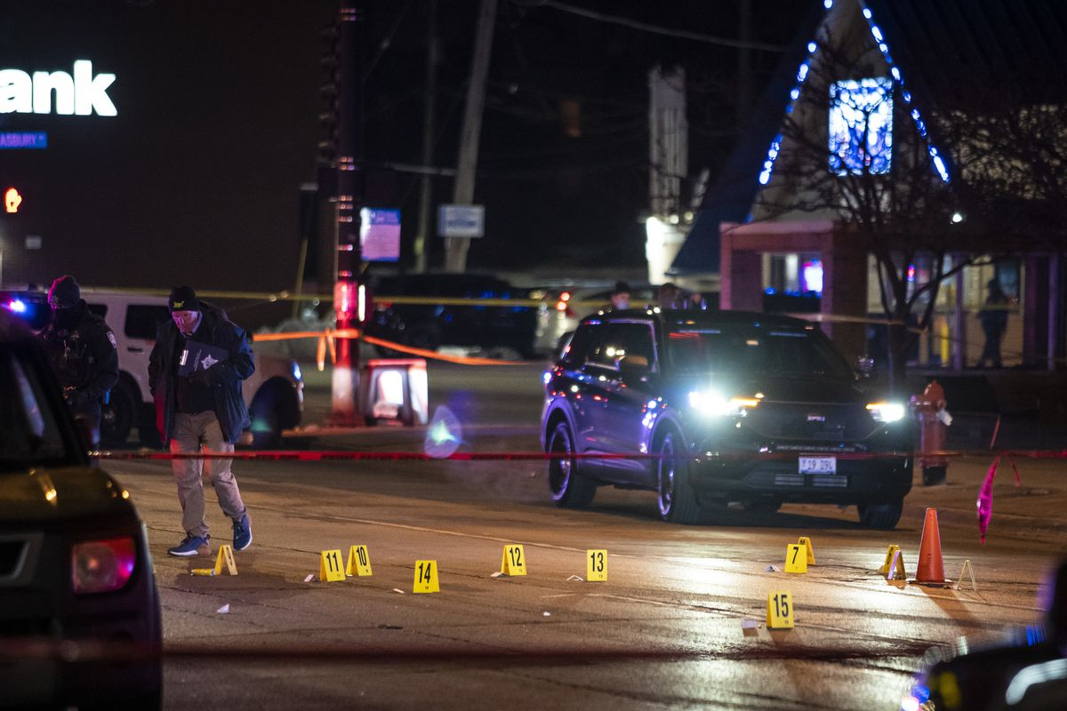 Police investigate a shooting inside an IHOP restaurant Saturday night in Evanston that left a woman critically wounded. The gunman was later killed by officers during a gun battle in a nearby parking lot.