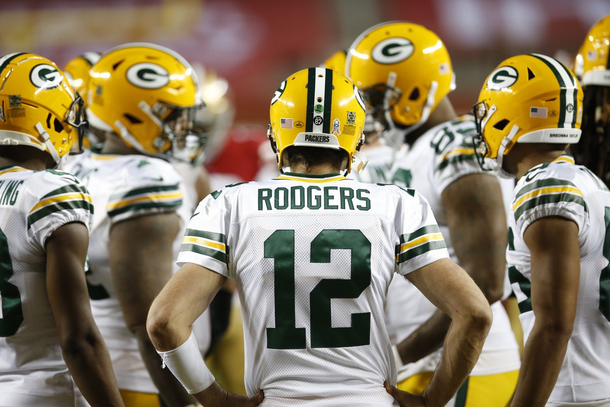 Aaron Rodgers #12 of the Green Bay Packers calls a play in the huddle during the game against the San Francisco 49ers at Levi's Stadium on November 3, 2020 in Santa Clara, California. The Packers defeated the 49ers 34-17.