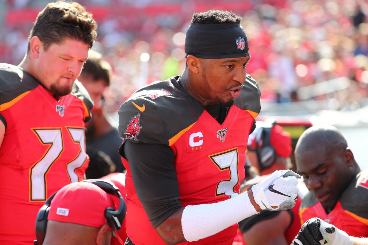 Tampa Bay Buccaneers quarterback Jameis Winston talks with offensive line after they scores a touchdown against the Atlanta Falcons during the first half at Raymond James Stadium.