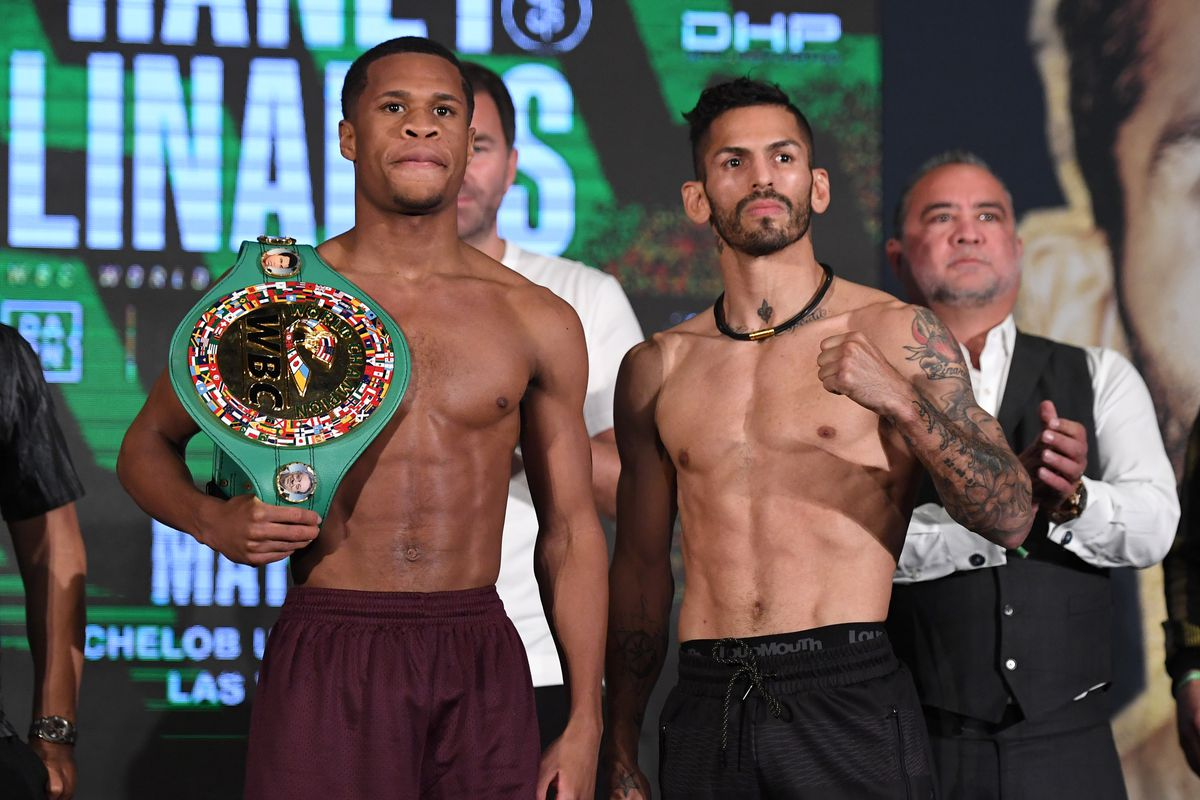 Devin Haney (L) and Jorge Linares pose during the ceremonial weigh-in at Mandalay Bay Resort and Casino on May 28, 2021 in Las Vegas, Nevada. The two will meet for WBC lightweight title fight at the Michelob ULTRA Arena in Las Vegas on May 29.