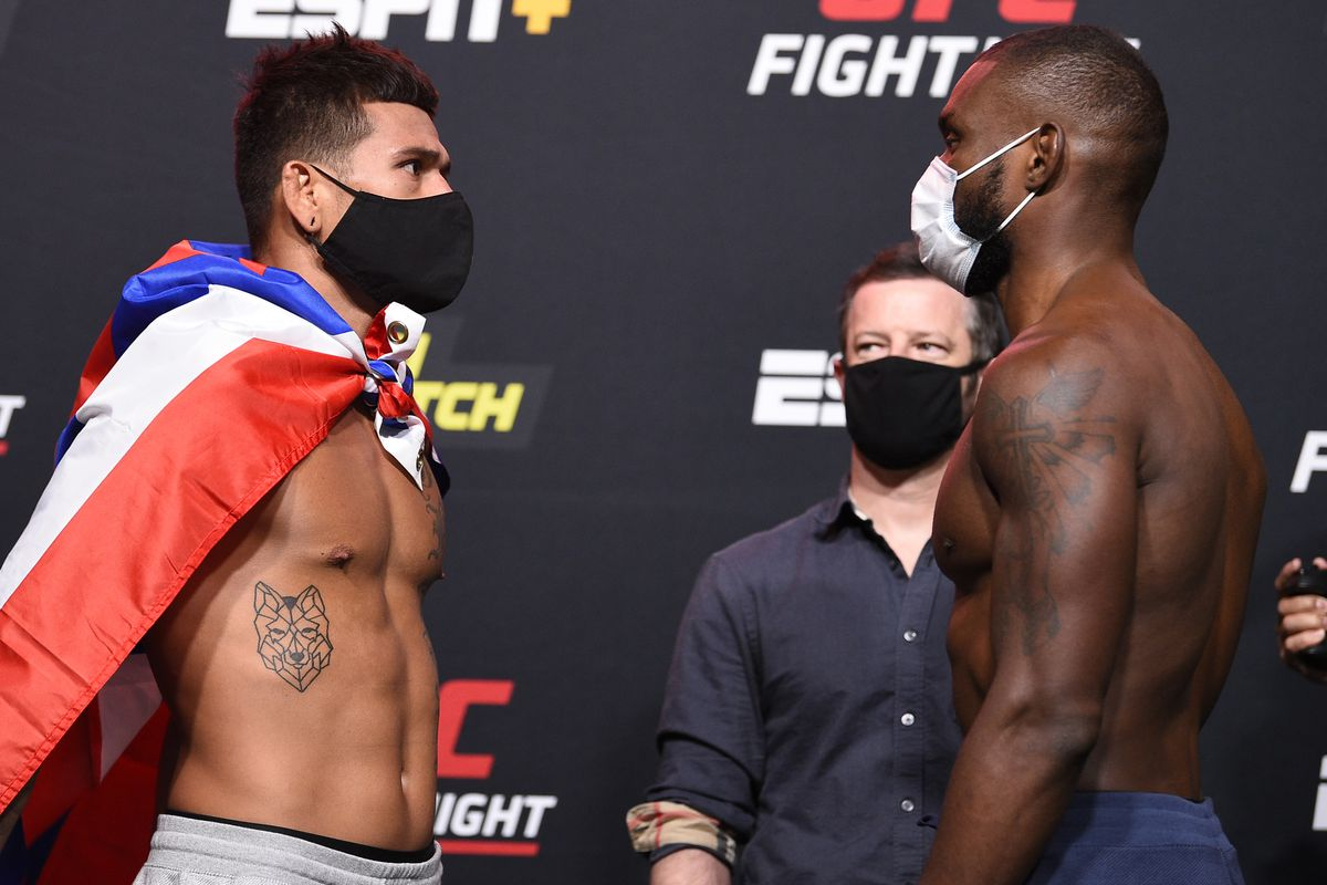 Opponents Maki Pitolo and Darren Stewart of England face off during the UFC Fight Night weigh-in at UFC APEX on August 07, 2020 in Las Vegas, Nevada.