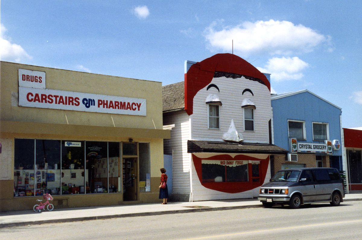 A 1993 photo of a pharmacy, a fudge store, and a grocery store in Carstairs, Alberta.