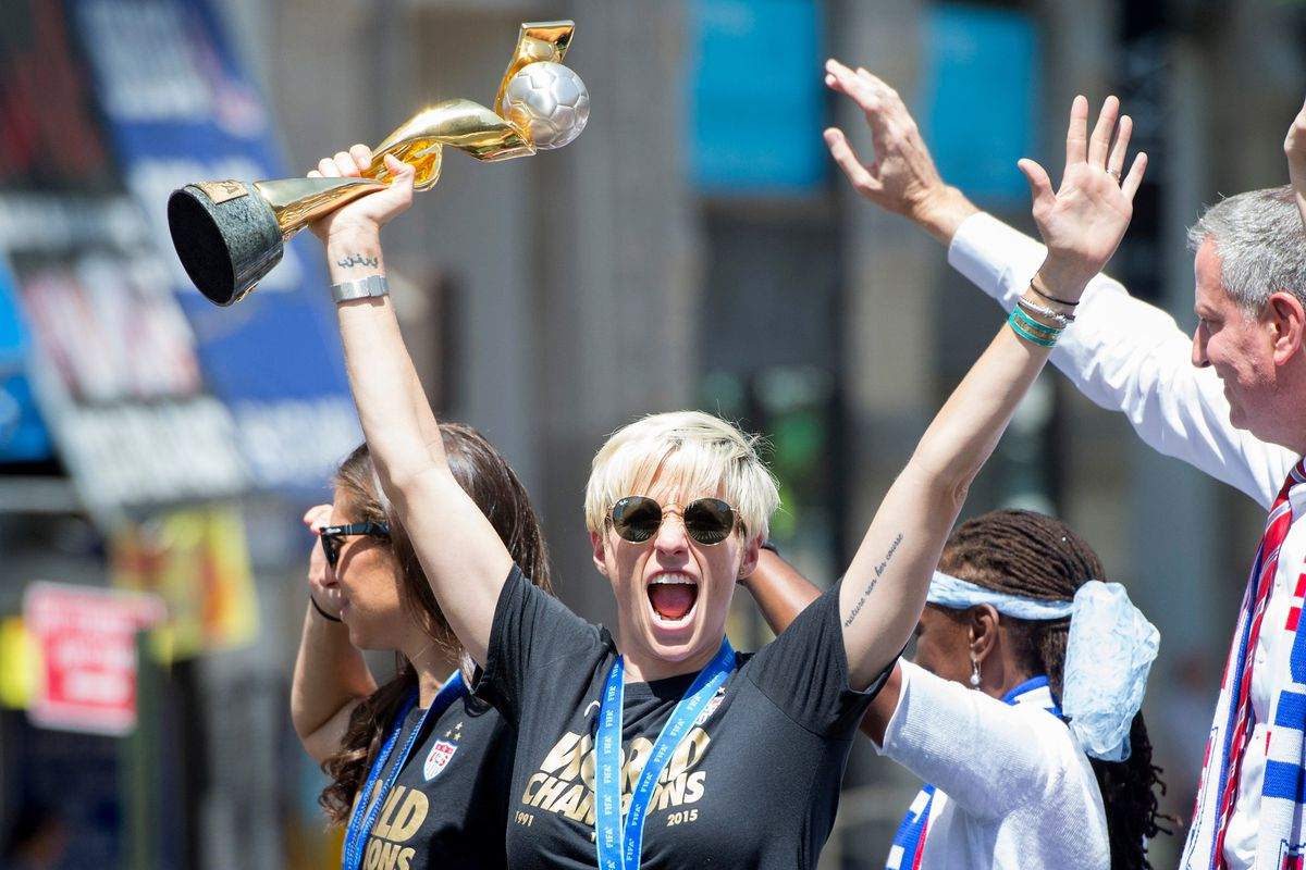 Megan Rapinoe holds the 2015 World Cup soccer trophy