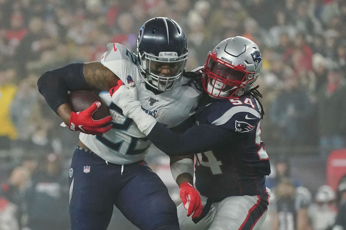 New England Patriots outside linebacker Dont'a Hightower tackles Tennessee Titans running back Derrick Henry during the first quarter at Gillette Stadium.