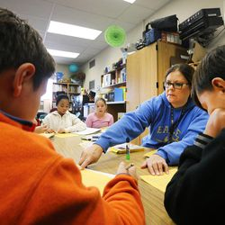 Teacher Lisa Hubbard helps some of her students at East Midvale Elementary on Monday, Sept. 25, 2017.