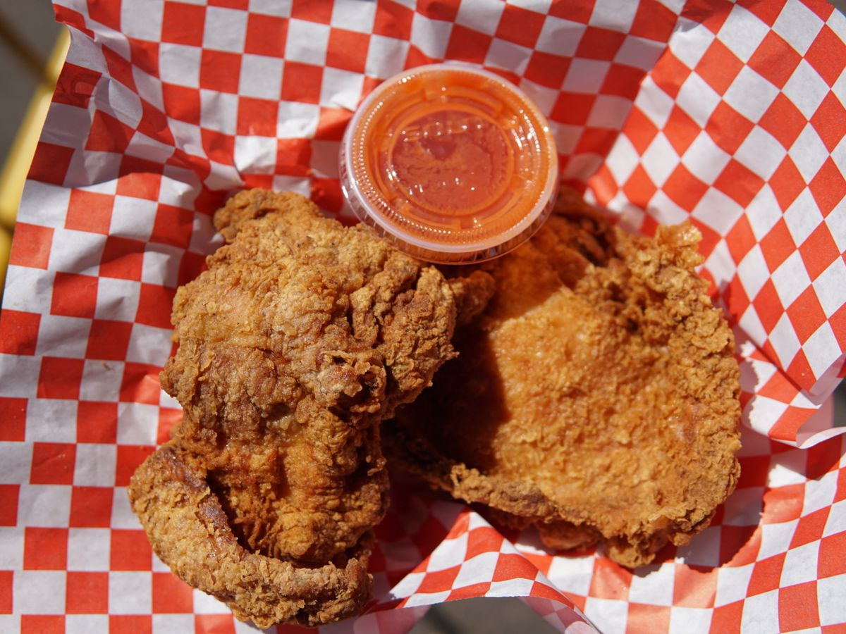 Two pieces of crispy, tender fried chicken from Ms. T's