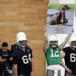 Tanner Magnum holds up a sign during BYU spring football practice at BYU in Provo on Friday, March 22, 2013.