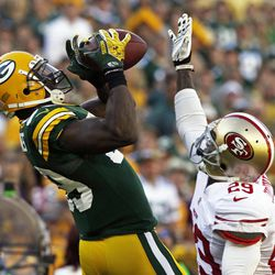 Green Bay Packers' James Jones (89) catches a pass in front of San Francisco 49ers' Chris Culliver (29) during the first half of an NFL football game Sunday, Sept. 9, 2012, in Green Bay, Wis.