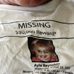 In this March 27, 2012 photo, Jeff Hanson wears a shirt for his missing step-granddaughter at his home in Portland, Maine. Hanson decided he needed to do something constructive as the investigation drew out, so he created the first of two websites aimed at drawing attention to Ayla Reynolds, the Maine toddler who disappeared on the night of Dec. 16 from her father's home in Waterville. The original website has received more than 1 million clicks, and there are now more than a dozen websites, blogs and Facebook pages dedicated to the case of the blond, blue-eyed youngster, helping to raise awareness along with billboards, posters and other conventional means of spreading the word about missing children.