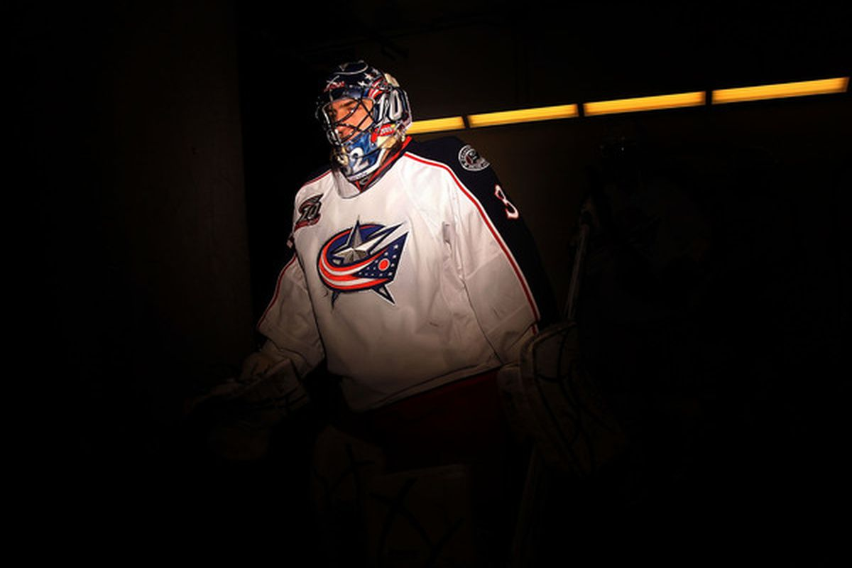 DALLAS TX - FEBRUARY 13:  Goaltender Mathieu Garon #32 of the Columbus Blue Jackets walks to the ice before a game against the Dallas Stars at American Airlines Center on February 13 2011 in Dallas Texas.  (Photo by Ronald Martinez/Getty Images)