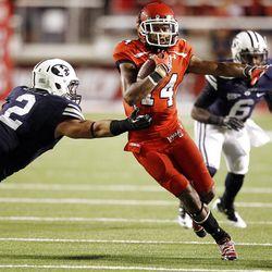 Utah Utes wide receiver Reggie Dunn (14) runs by Brigham Young Cougars linebacker Spencer Hadley (2)   in Salt Lake City  Sunday, Sept. 16, 2012.