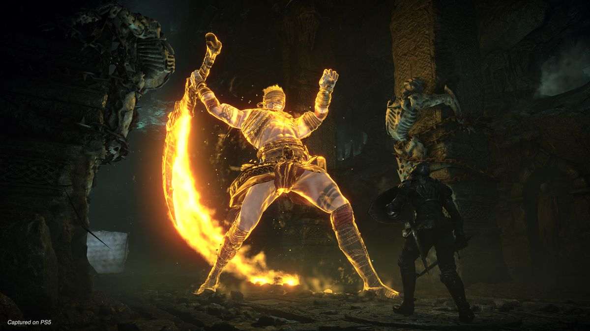 confronting a giant glowing enemy in Demon's Souls (remake)
