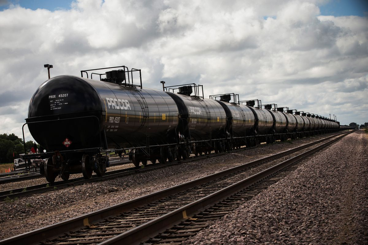 Oil containers sit at a train depot on July 26, 2013 outside Williston, North Dakota.