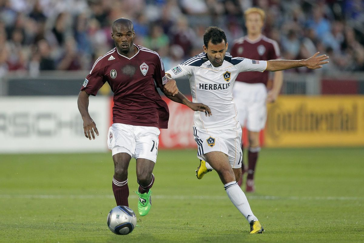 COMMERCE CITY, CO - Omar Cummings #14 of the Colorado Rapids battles with Juninho #19 of the Los Angeles Galaxy (Photo by Doug Pensinger/Getty Images)