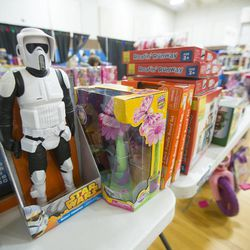 Toys are displayed on the tables as the 19th annual Candy Cane Corner holiday store prepares to open in the old Granite High School pool building in South Salt Lake on Monday, Nov. 30, 2015.