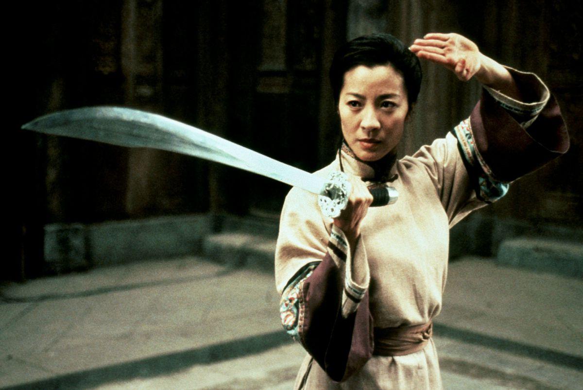 Michelle Yeoh preparing for battle in Crouching Tiger, Hidden Dragon.