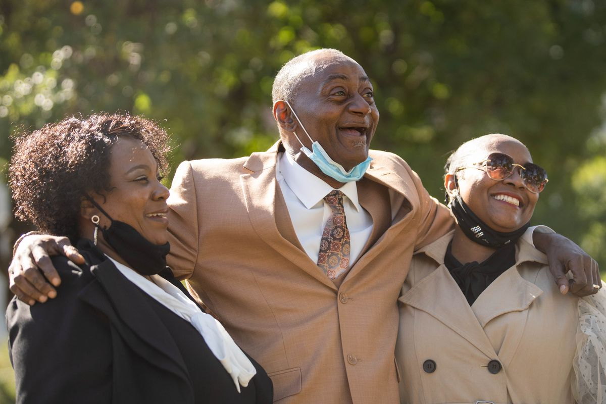 Jackie Wilson, center, his wife Sandra, left, and niece Candace, right, laugh outside Cook County Criminal Court after a hearing about prosecutorial misconduct Friday afternoon, Oct. 2, 2020.