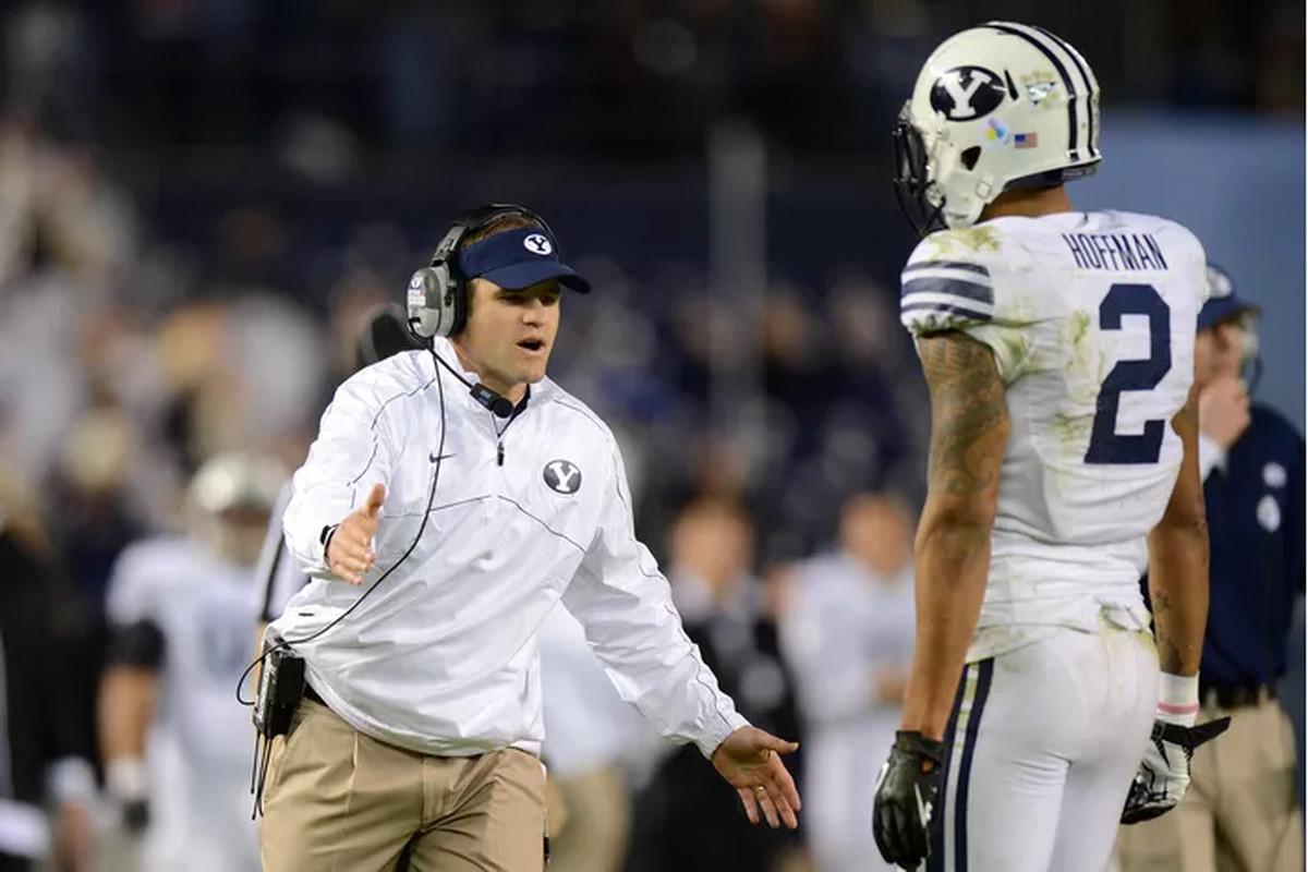 Ben Cahoon coaching Cody Hoffman.