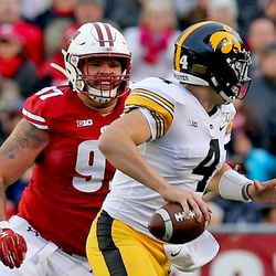 After the UW fumble, the Badger defense forced a field goal. Isaiahh Loudermilk seen here smiling as he chases Iowa off the field.