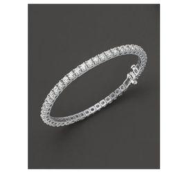 "<a href=""http://www1.bloomingdales.com/shop/product/diamond-tennis-bracelet-in-14-kt.-white-gold-8.0-ct.-t.w.?ID=448325&PseudoCat=se-xx-xx-xx.esn_results""> Bloomingdale's diamond tennis bracelet</a>, $7920 (originally $22,000) bloomingdales.com"