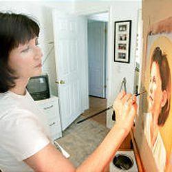 Sandy Freckleton Gagon painting in her studio.