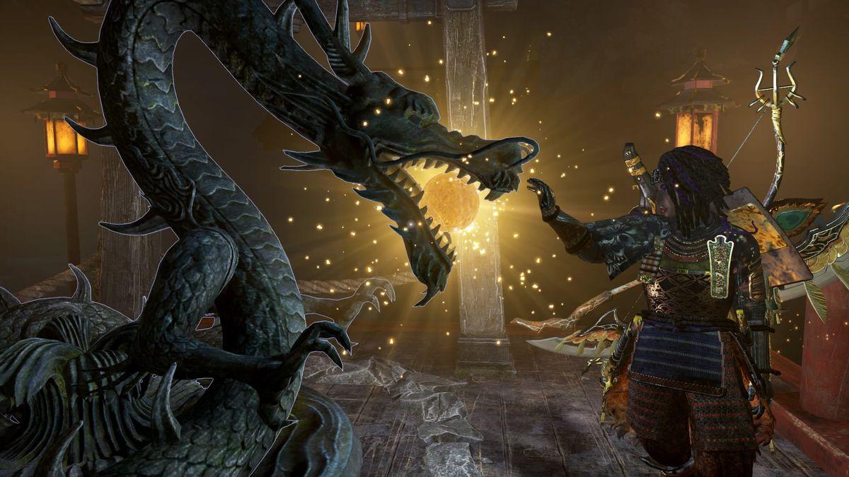Nioh 2 protagonist Hide reaches towards a dragon