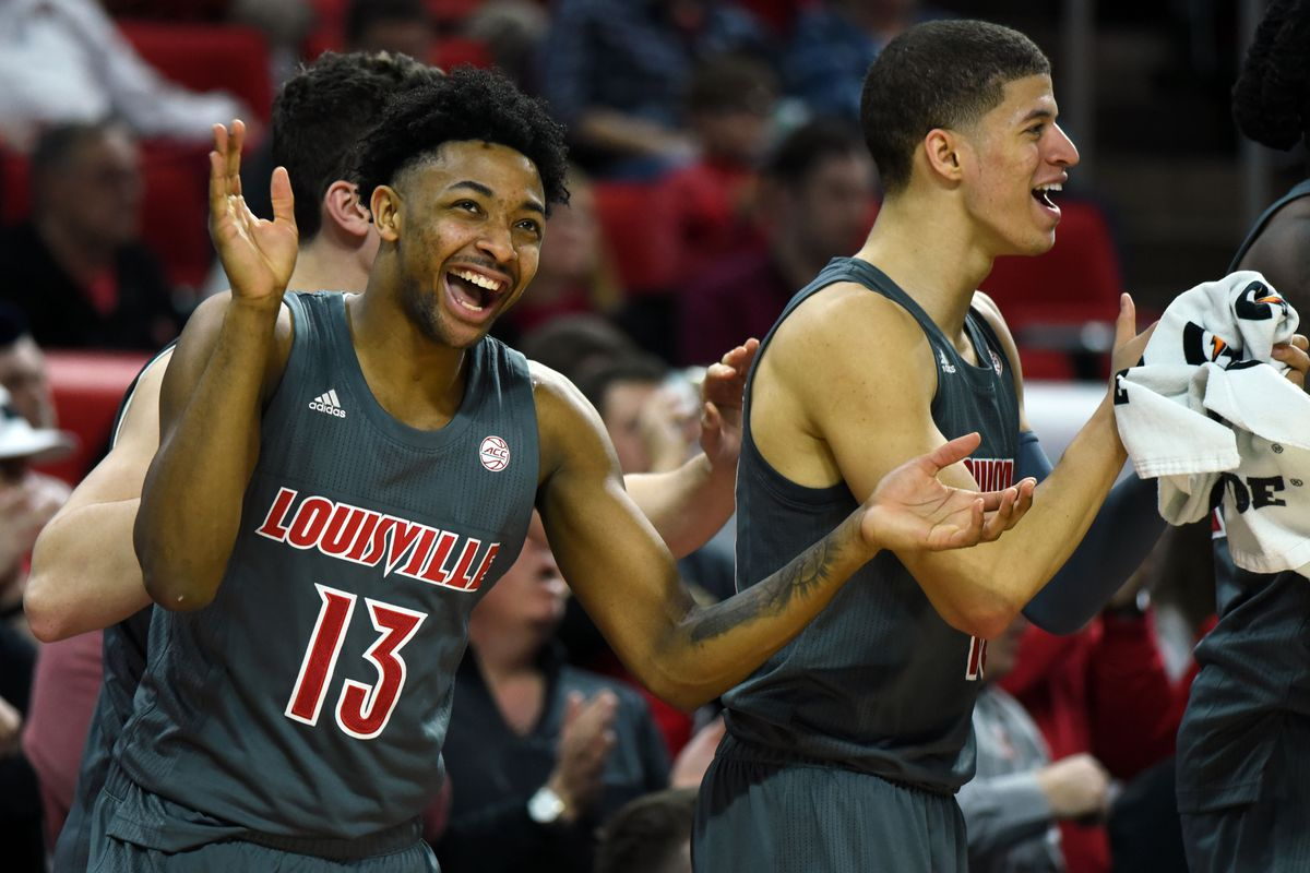 Louisville Cardinals guard David Johnson and the bench react during the second half against the North Carolina State Wolfpack at PNC Arena. The Cardinals won 77-57.