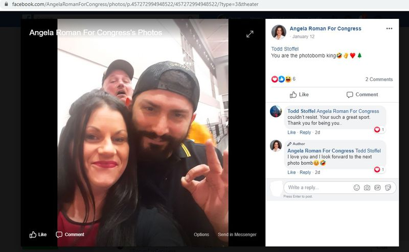 "Angela Roman and Proud Boy Matteo Dagradi making the white-power ""ok"" sign, with Todd Stoffel in the background, at the Vanguards of Victory ceremony."
