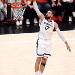 Memphis Grizzlies center Jonas Valanciunas (17) goes up for a dunk as the Utah Jazz and Memphis Grizzlies play Game 2 of their NBA playoffs first round series at Vivint Arena in Salt Lake City on Wednesday, May 26, 2021. Utah won 141-129.