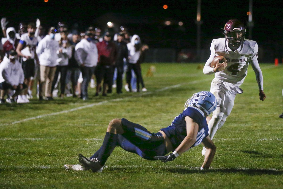 Maple Mountain QB Tyler Nelson runs past Salem Hills' Easton Cook and scores during double overtime at Salem Hills High on Wednesday, Oct. 14, 2020.