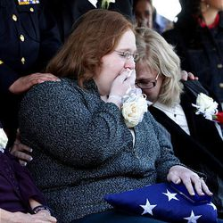 Kaitlyn Koehn Skinner and her mother, Susan Koehn, attend the interment of Kaitlyn's husband, North Salt Lake Police Officer Charles Skinner, at Bountiful City Cemetery on Friday.