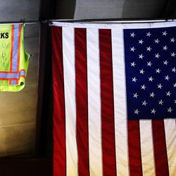 A safety vest hangs in the Woods Cross Public Works shop next to the U.S. flag in Woods Cross on Tuesday, Aug. 9, 2016.