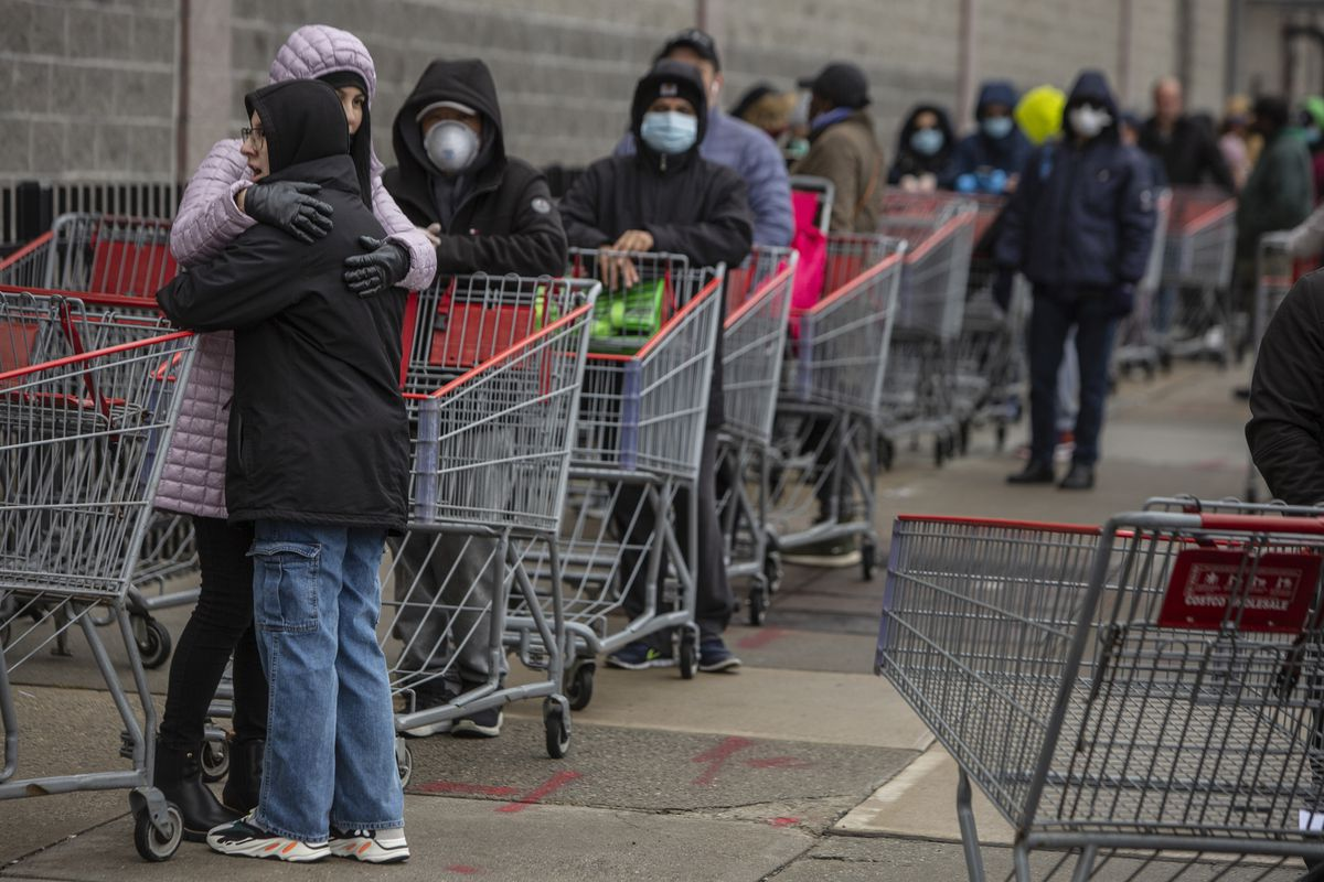 Customers line up to shop at a Costco in Brooklyn