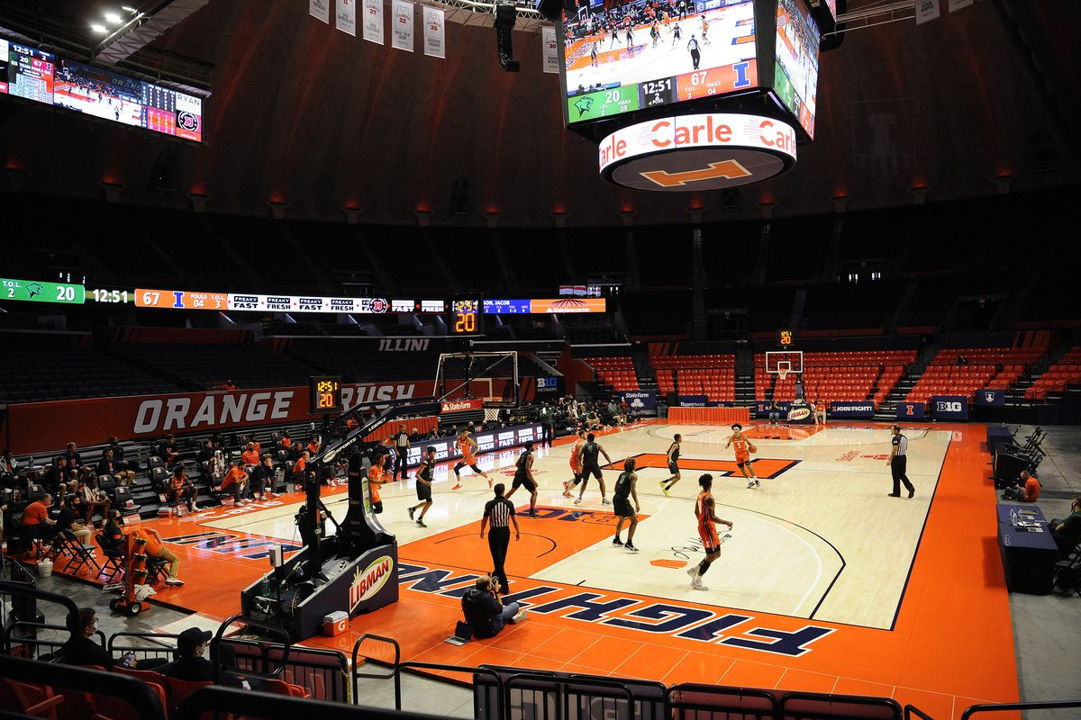 A college basketball game between the Chicago State Cougars and the Illinois Fighting Illini.