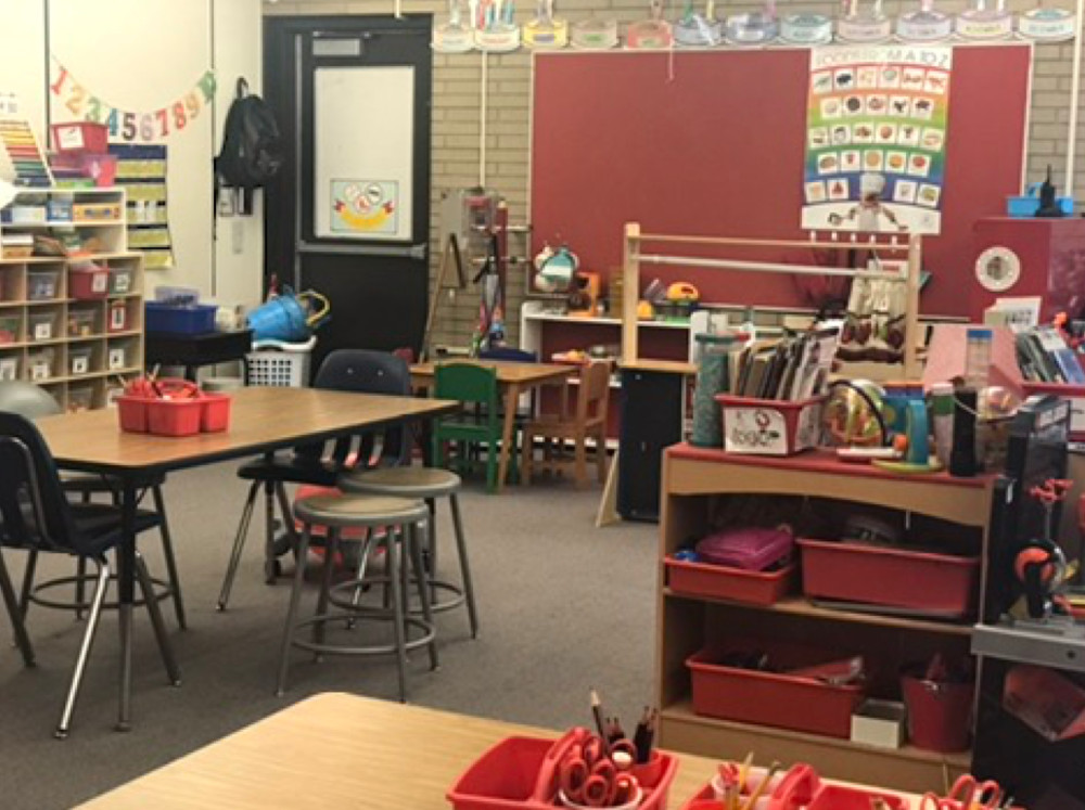 Kindergarten teacher Laura Henry purchased the housekeeping table and chairs, everything on the wall and shelves, the books in the bin, tool bench, and playground buckets for her Aurora classroom.