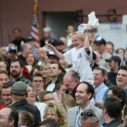 A young boy catches a T-shirt at a rally in Draper at the American Preparatory Academy Saturday, March 19, 2016.