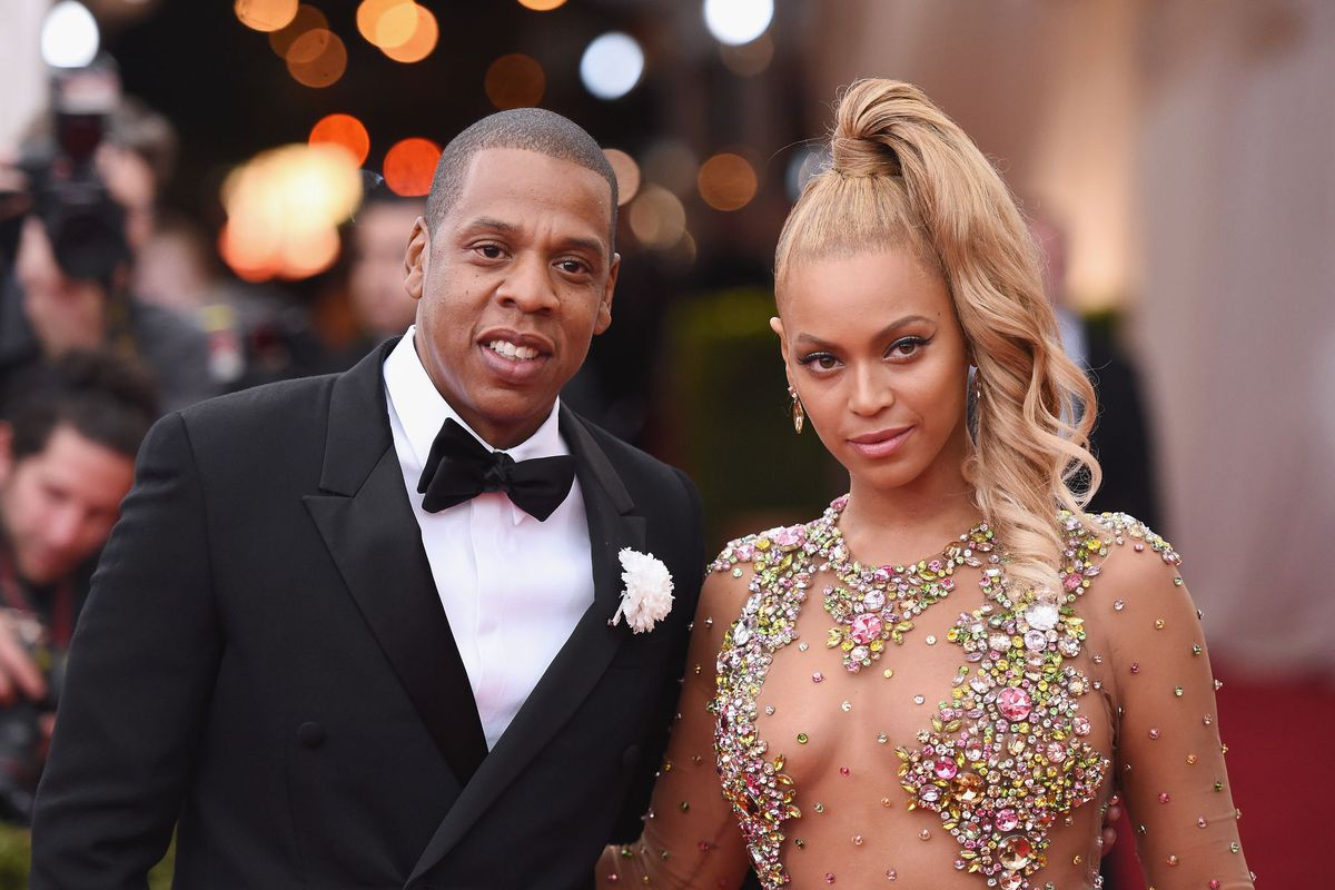 Tidal owners Jay-Z and Beyoncé, looking desperate. (Photo by Mike Coppola/Getty Images)