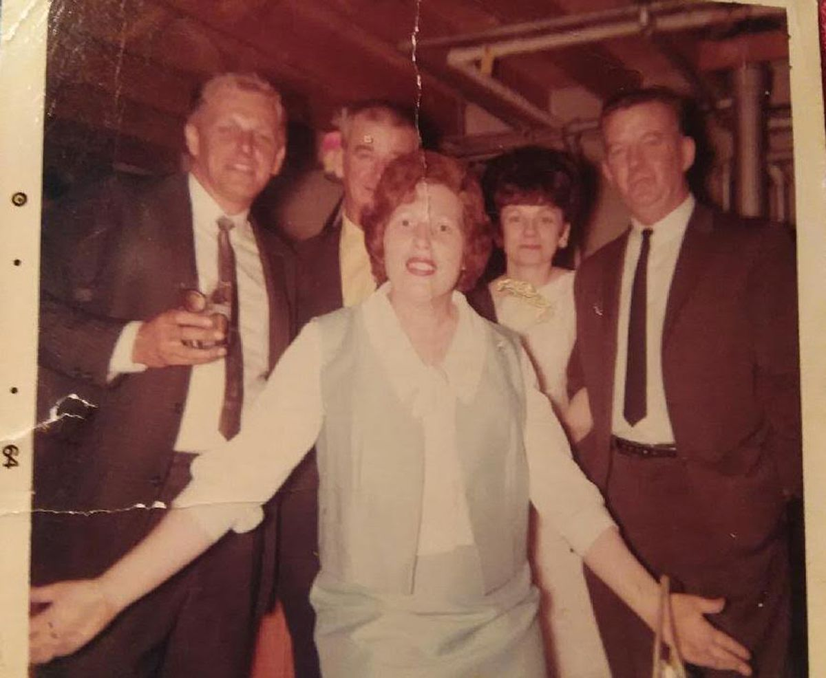 Georgia Sheehan (center) with her husband Eugene (right) in 1964 at one of the many house parties they and their friends would throw.