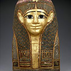 """""""Mummy mask,"""" 100 A.D. (gilded and painted cartonnage, 18 1/2 by 11 by 8 1/2 inches), Egypt."""