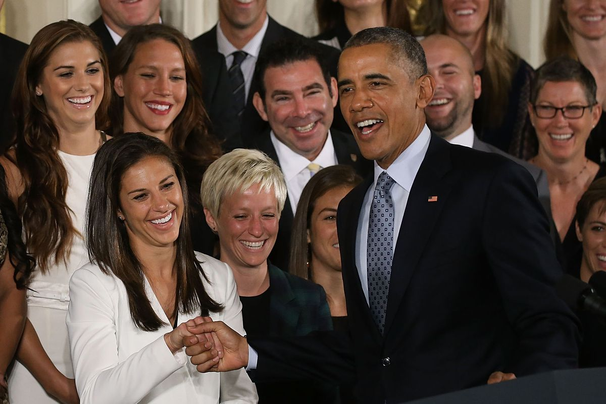 President Obama shakes hands with Rutgers great Carli Lloyd after she led the United States Women's National Soccer Team to a World Cup title.