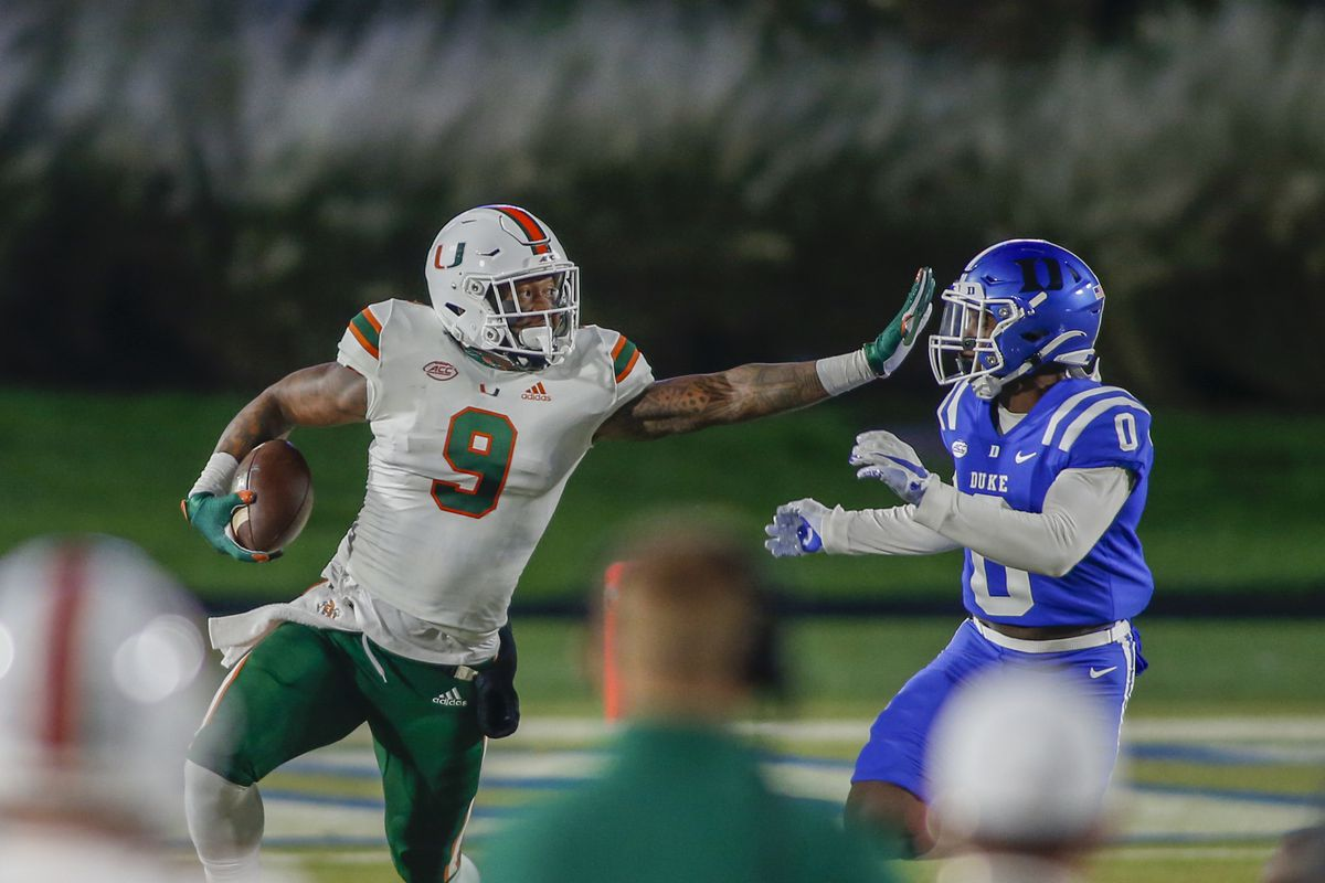 Miami Hurricanes tight end Brevin Jordan carries the football against Duke Blue Devils safety Marquis Waters in the first half at Wallace Wade Stadium.