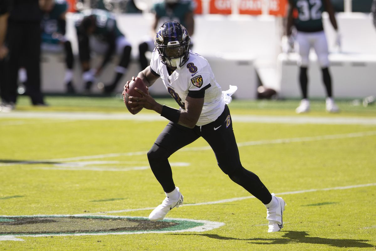 Lamar Jackson #8 of the Baltimore Ravens runs with the ball against the Philadelphia Eagles at Lincoln Financial Field on October 18, 2020 in Philadelphia, Pennsylvania.