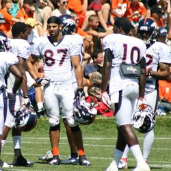 Denver Broncos WRs (left to right) Trindon Holliday, Eric Decker, Gerell Robinson talk things over between drills on Wednesday.
