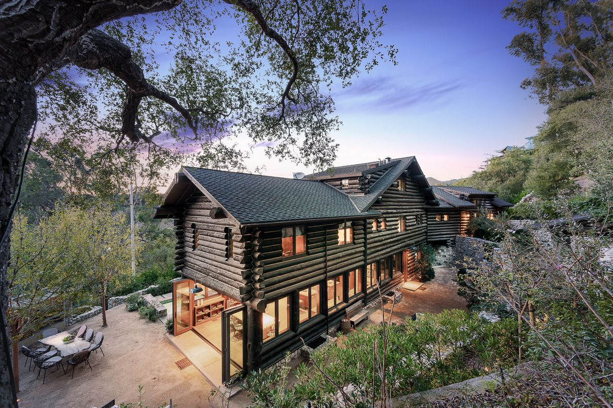 Luxurious Rustic Canyon log cabin with wild past lists for $7 995M