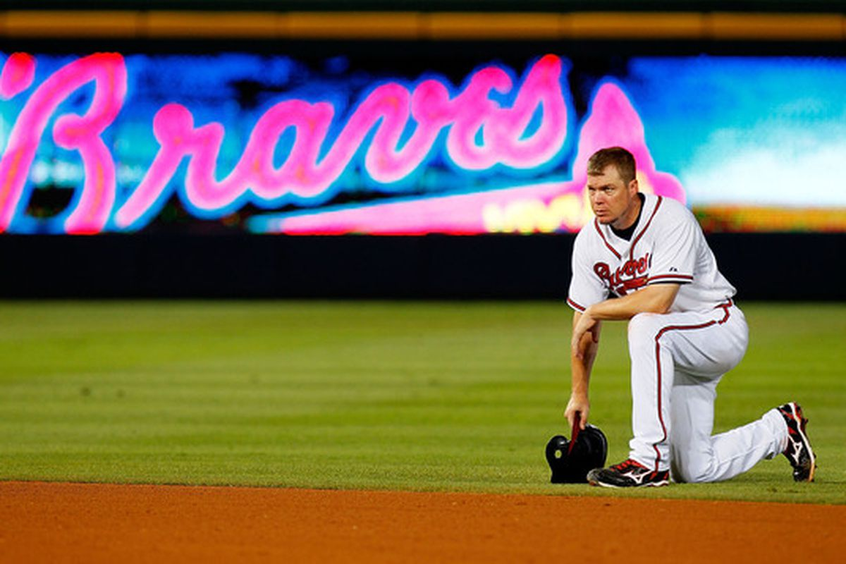 ATLANTA - JUNE 30:  Chipper Jones #10 of the Atlanta Braves kneels behind second base during a pitching change by the Washington Nationals at Turner Field on June 30